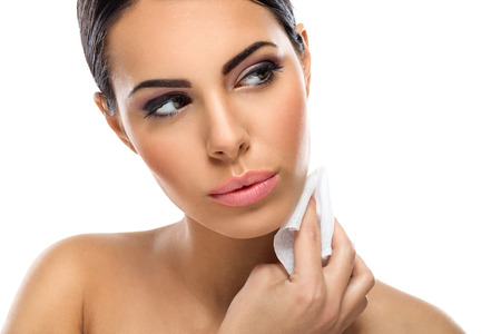 beautiful woman cleaning skin with wet tissues photo