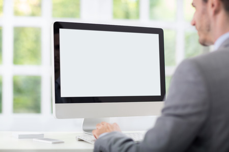 Businessman front of empty computer screen Stock Photo