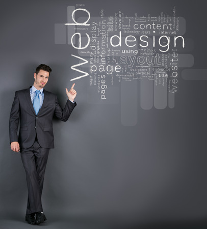 businessman pointing at web design words photo