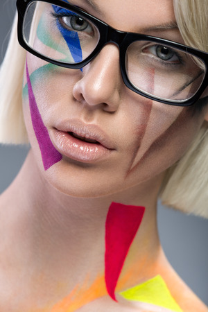 High fashion look, glamor portrait of beautiful sensual  stylish mode in glasses with bright colorful make up with perfect clean skin  photo