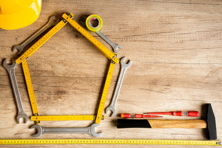 construction background, different tools on the wood plank. photo