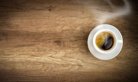 cup of coffee on wooden background with copy space