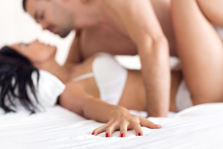 sex activity: Couple in ecstasy in bed  Stock Photo