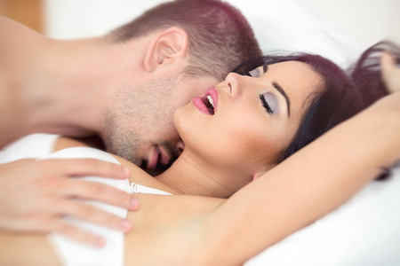 sex on bed: Man passionately engaged in sex with a beautiful girl