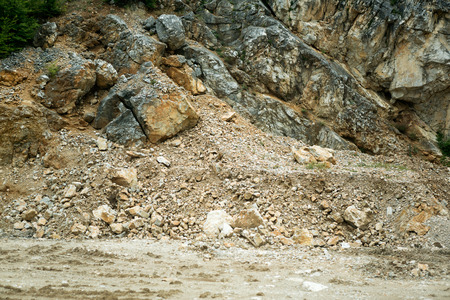mud slide:  road is blocked by a land slide of rock and debris to where it is a hazard for drivers in cars