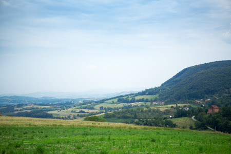 littoral:  Landscape of green nature with village  Stock Photo