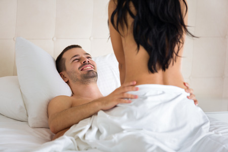 sex activity: erotic young couple making love in bed Stock Photo