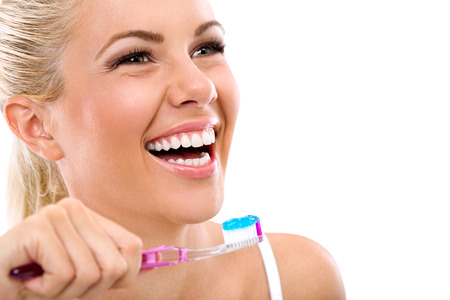 smile close up:  Laughing young woman with healthy teeth holding a tooth-brush Stock Photo