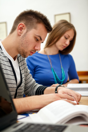 college student making note during lecture