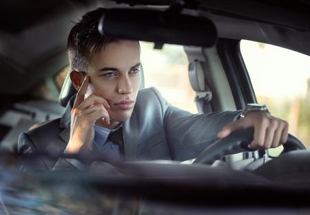 Elegant male model in car photo