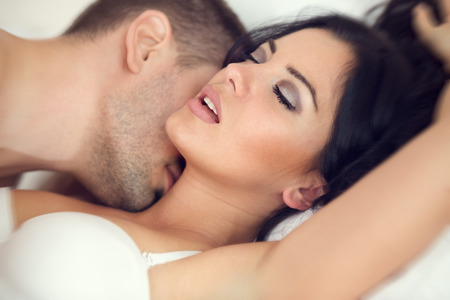 woman sex: amorous couple making love in bed