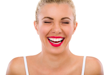 young woman with beautiful teeth laughs Фото со стока
