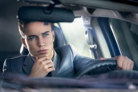 elegance  young man driving his car Archivio Fotografico