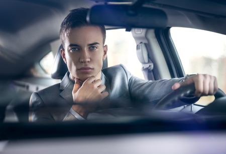elegance stylish men night in car photo