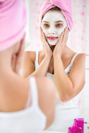 Beauty day, young girl  with a towel on her head and  cosmetic mask Stok Fotoğraf - 34939091