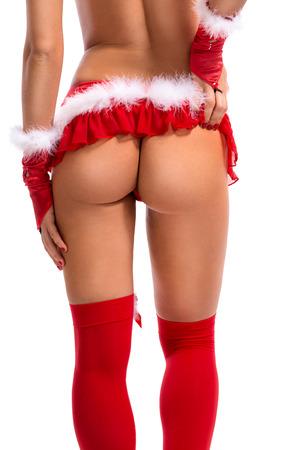 nude female buttocks: sexy buttocks of female Santa Claus Stock Photo