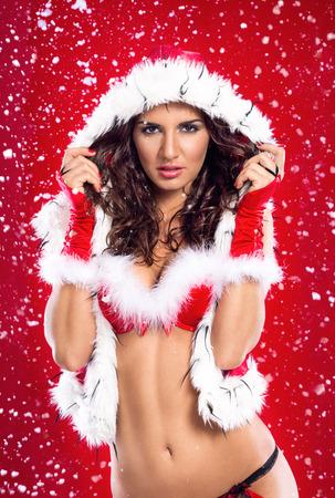 naked young women: красивая привлекательная девушка носить сексуальный одежды Санта-Клауса Фото со стока