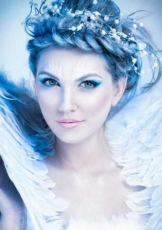 Close up portrait of winter queen with artistic make-up photo