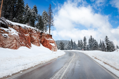 frost covered: Empty snow covered road in winter landscape Stock Photo