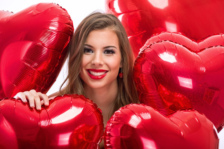 anniversary sexy: Love woman smiling with red heart shaped balloon