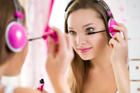 Trendy teen girl makeup and listening music
