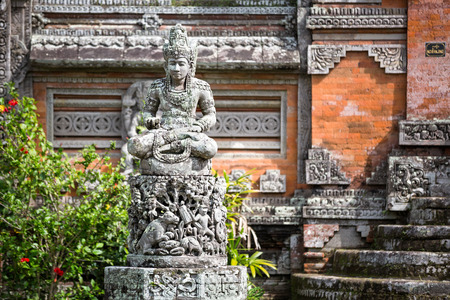 deities: Statues and carvings depicting demons, gods and Balinese mythological deities