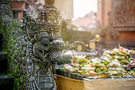 Statues of Hindu God or demons with offerings, Bali, Indonesia photo