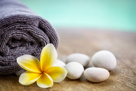 White frangipani on towel in the spa, close up Stock Photo