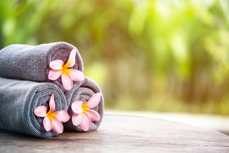 Tropical spa, beautiful fresh pink frangipani flower, outdoor setting spa photo