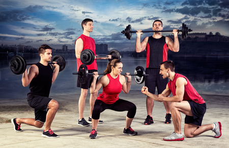 body pump: Group people having lifting training with trainer Stock Photo