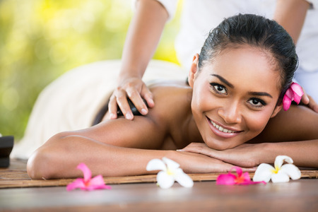 bali massage: Beauty smiling woman getting relaxation in spa salon