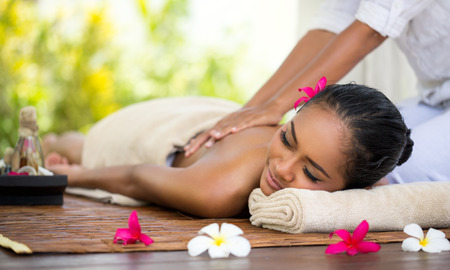 spas: Beautiful Balinese woman getting a massage Stock Photo