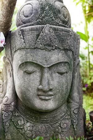 stone buddha: Stone Buddha statue face, close up Stock Photo