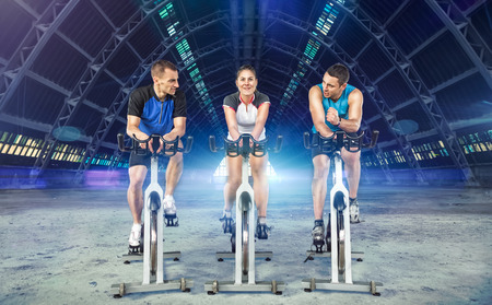 young active people riding exercise bikes Stock Photo