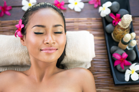 Serene woman with closed eyes enjoying in spa treatment Stok Fotoğraf