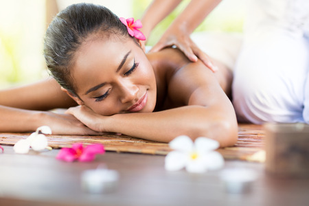 hands massage: Relaxing massage of back for young beautiful woman in spa salon Stock Photo