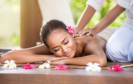 Smiling woman enjoying a massage, back massage