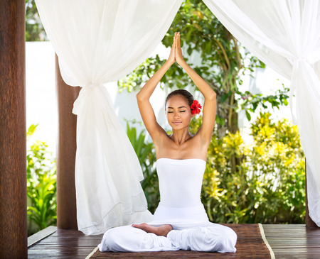 yoga outside: young woman doing yoga outside in natural environment