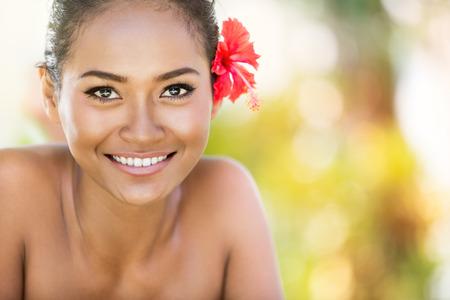young beautiful Balinese woman, looking at camera