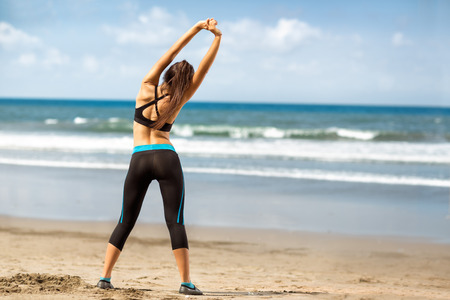 'fit body': Fitness woman exercising and stretching arms on beautiful summer day Stock Photo