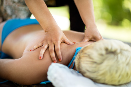 woman lying down: woman lying down relaxing herself and getting a massage back