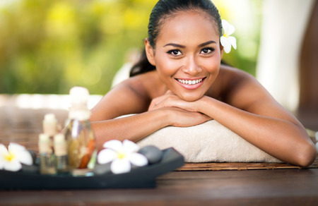 Beautiful young woman at spa outdoor Stock Photo