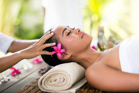 massage face: Young woman receiving recreation Balinese massage in spa
