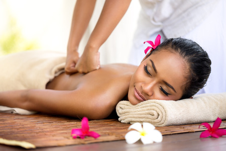 woman in spa: Balinese massage in spa environment,  deep massage of back