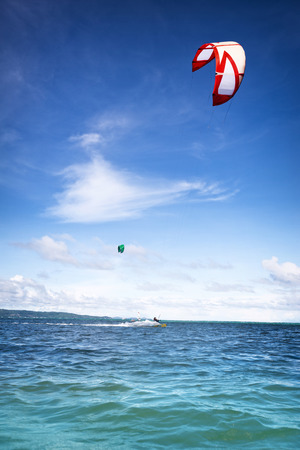 water sports: Kite boarder on surfing on beautiful sea Stock Photo