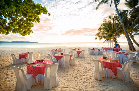 ceremony: Setting arrangement at a wedding ceremony on the beach
