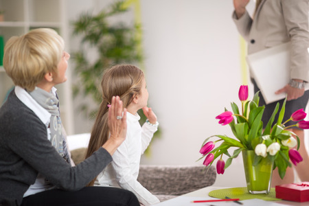 staying: Girl greeting her mother and stay at home with her grandmother, gesture, happiness, generation, home and people concept
