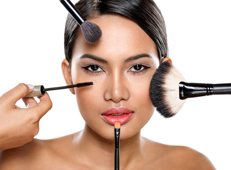 eye brow: beautiful woman with make-up brushes near attractive face, makeup, cosmetic,  applying make-up