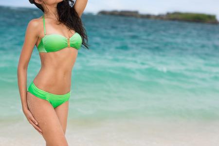 asian bikini: Attractive female body with modern bikini, sea in background