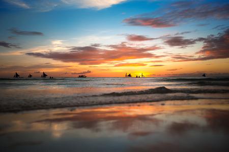 beach sunset: Tropical beach at beautiful colorful sunset Stock Photo